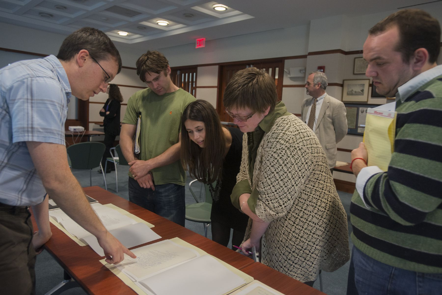 Graduate students study Samuel Beckett's papers at Olin Library.
