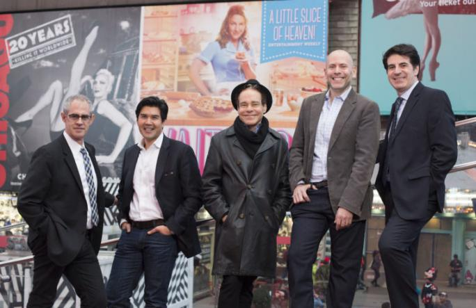 Washington University alumni contribute to the cultural conversation through their work on Broadway: (from left) Keith Sherman, Pun Bandhu, Steven Sater, Eric Schnall and Michael Sinder gather in Times Square. (Photo: Jennifer Weisbord, BFA '92)