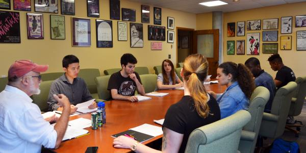 Carter Lewis, Playwright in Residence leads his playwriting class in discussion of their own works.