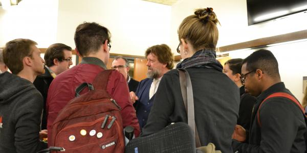 Oskar Eustis visits with graduate students after his March 2018 Helen Clanton Morrin lecture.